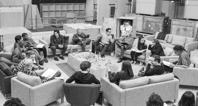 Writer/Director/Producer J.J Abrams (top center right) at the cast read-through of Star Wars Episode VII at Pinewood Studios with (clockwise from right) Harrison Ford, Daisy Ridley, Carrie Fisher, Peter Mayhew, Producer Bryan Burk, Lucasfilm President and Producer Kathleen Kennedy, Domhnall Gleeson, Anthony Daniels, Mark Hamill, Andy Serkis, Oscar Isaac, John Boyega, Adam Driver and Writer Lawrence Kasdan. Credit: David James
