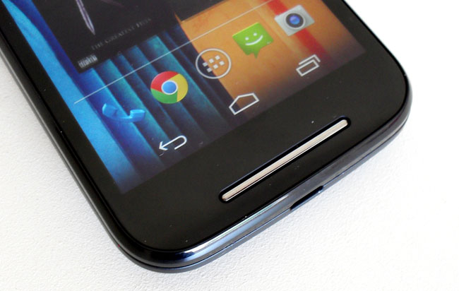 A chrome strip protects the speaker beneath which sounds better than the one in the Moto G