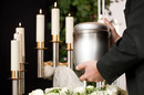 Undertaker with urn of ashes