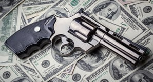 Gun and dollars