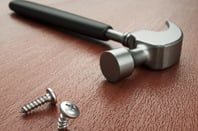 A hammer and bent screw