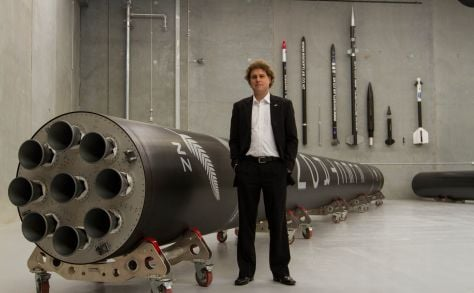 Rocket Lab's Peter Beck with a model of the launcher