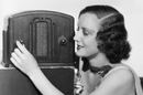 Old-timey 1940s woman tunes AM radio