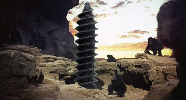 Apes gather around a giant screw