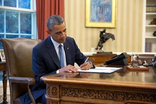 President Obama signs the Unlocking Consumer Choice and Wireless Competition Act