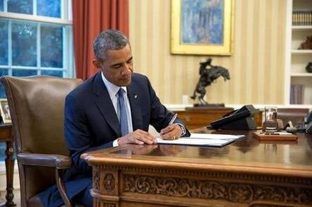 Presidetn Obama signs the Unlocking Consumer Choice and Wireless Competition Act