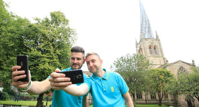 Chesterfield's twisted spire: Local Store Manager, Adam Osowski, with fellow EE employee