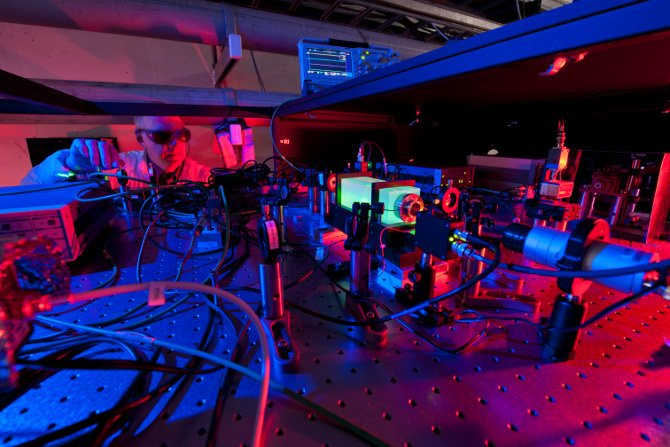 A Fermilab scientist works on the laser beams at the heart of the Holometer experiment