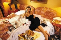 The fashion world's most privileged urchin lounges in a luxury hotel in Paris, 1993. © Geoff Wilkinson/RexUSA