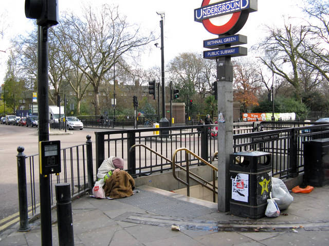 Entrance to Bethnal Green Underground station A homeless person sits at the top of the steps, too dispirited even to beg