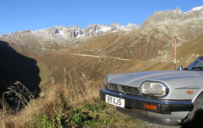 Fuel efficient Jaguar XJ-S on the Furka Pass in the Swiss Alps