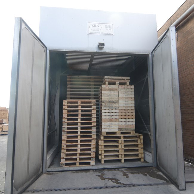 The treatment kiln filled with pallets