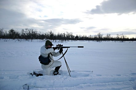 Sportsman with moderated rifle in snow. Pic: Juha Perovuo