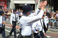 Policeman claps in London street