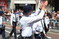 Policeman claps in London street
