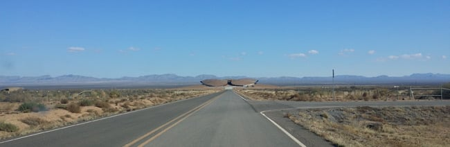 The road leading to the distant spaceport