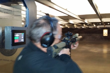 Lester firing an AR-16 at the gun range