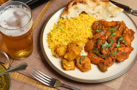 Chicken Jalfrezi and rice with a beer. Pic by Shutterstock