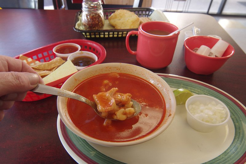 A bowl of menudo in a Texas cafe