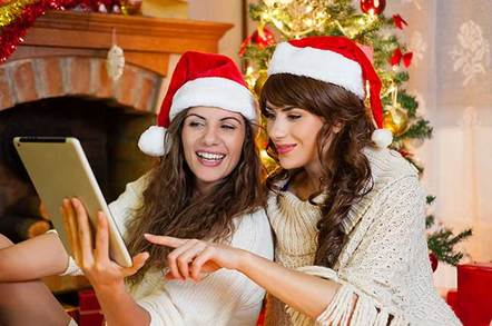 "Photo From <a target=""_blank"" href=""http://www.shutterstock.com/pic-232507384/stock-photo-christmas-holiday-happy-girl-friends-looking-at-something-on-digital-touch-screen-tablet-pc.html?src=9mJhlJ8bDz_0JV9eZNUpyQ-1-34"">Shutterstock</a>"