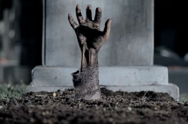 Zombie rising from the grave