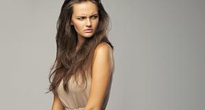 Pretty woman looks miffed. Copyright: Danil Nevsky via Shutterstock http://www.shutterstock.com/pic.mhtml?id=149618984&src=id