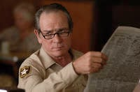 Tommy Lee Jones delivers implied facepalm. From No Country for Old Men  Copyright Miramax Pictures. 2007.