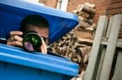 Spy hides in dustbin, lifts lid to take photograph