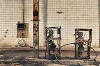 A rusty petrol pump at an abandoned gas station. Pic by Silvia B. Jakiello via shutterstock