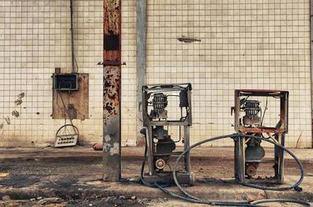 A rusty petrol pump at an abandoned gas station. Pic by Silvia B. Jakiello via shutterstock