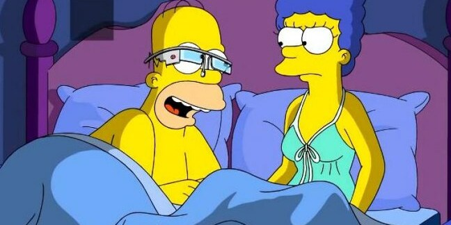 Homer Simpson wearing a Glass headset to bed