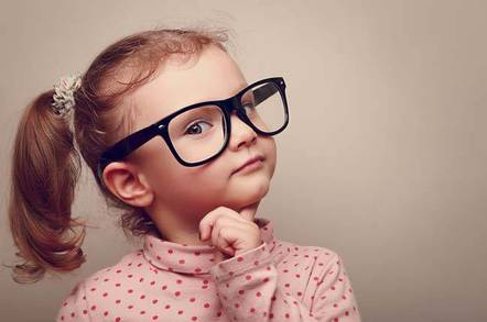 Red-haired child in glasses looks thoughtful. Image via Shutterstock -  Copyright: Sofi photo