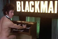 Monty Python's Terry Gilliam as the nude organist in Monty Python's Flying Circus