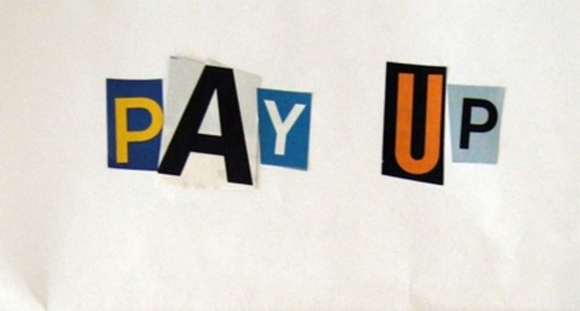 "Ransom note saying ""Pay Up"" in blackmail type"