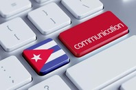 Keyboard where return key is marked communication and to its left is a key with the Cuban flag. Copyright: xtock, Photo via Shutterstock