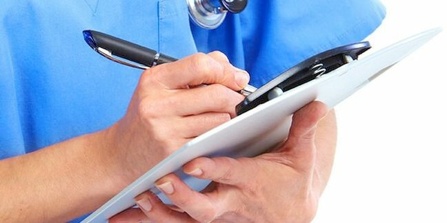 Crop of doctor with pen and clipboard