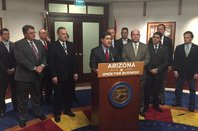 Arizona Governor Doug Ducey and officials in conference