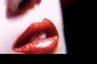 Close-up of a woman's lips, slightly pixelated as if on a CRT TV. http://www.sxc.hu/photo/20984  Pic via SXC - no restrictions