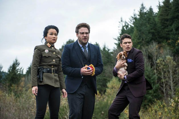 James Franco clutches puppy alongside Seth Rogen in a still from The Interview
