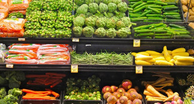 Fruit and vegetables on display on the shelves of a supermarket