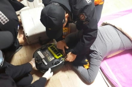 Woman being eaten  by vacuum cleaner