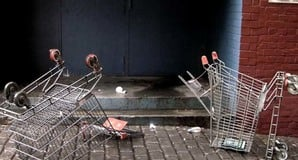 Two upended shopping trolleys in an alleyway. Photo by Cyron, licensecd under CC 2.0