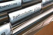 Files in manager's desk drawers: manila folder marked Redundancy Plan. Image via shutterstock