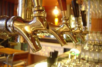 Beer taps at a pub. Via http://www.freeimages.com/