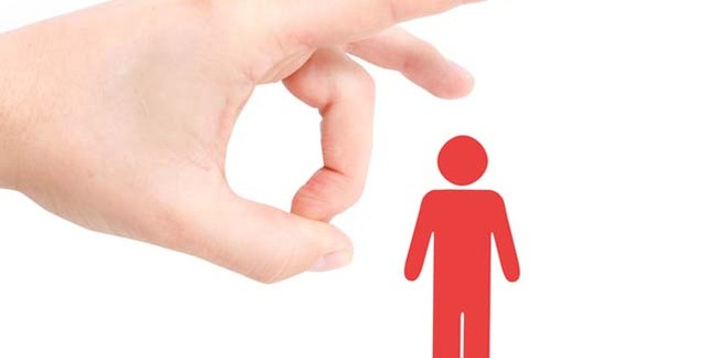 A large hand flicks an icon of a little red man. Image via shutterstock (Lasse Kristensen)