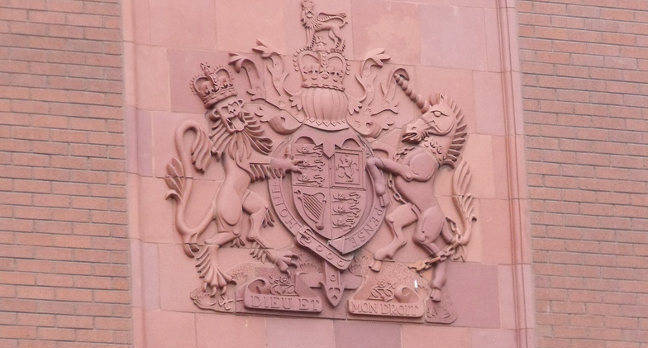 Royal coat of arms on a court building. Pic: Elliott Brown