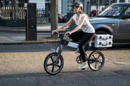 Woman rides a Ford modePro electric bike
