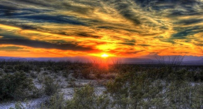 Sunset over the Texan desert. Photo by ArchBob, licensed under cc0 public domain
