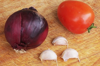 One onion, one tomato and three cloves of garlic