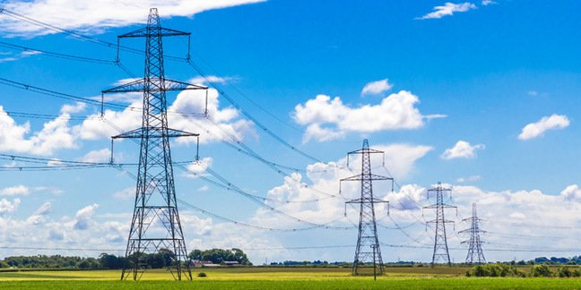 Traditional lattice pylons in the UK countryside